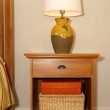 Wood furniture nightstand with lamp and bed. — Foto de Stock   #13125726