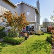 Stock Photo: Nicely landscaped back yard with house during spring in NorthWest USA.