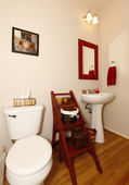 Small bathroom with sink and toilet and hardwood floor. — Stock Photo