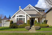 Classic new American house exterior in the spring. — Stock Photo