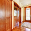 Luxury hallway and house entrance with cherry wood. - Zdjcie stockowe