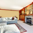 Large living room with sectional grey sofa and fireplace. - Lizenzfreies Foto