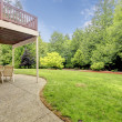Backyard of the houes with porch and green forest. — Stock Photo #13751769
