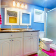 Kids Bathroom with blue walls and pink rug and towel. — Stock Photo