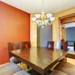 Stock Photo: Dining room in red and blue and black table.