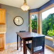 Stock Photo: Dining breakfast table near the kitchen with blue walls.