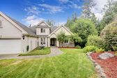 Grey beige large nice house exterior with summer landscape. — Stock Photo