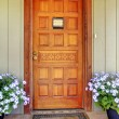 House wood carved old front door with blue flowers. — Stock Photo #13775433