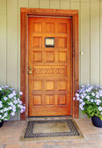 House wood carved old front door with blue flowers. — Stock Photo