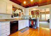 Cauntry farm house kitchen with wood ceiling. — Stok fotoğraf