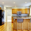 New classic kitchen with bar stools and hardwood. — Foto de Stock