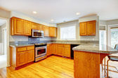 New classic wood large kitchen with grey countertop. — Stock Photo