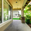 House covered porch with large window. — Stock Photo