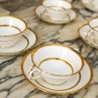 Antique white china cups with plates. — Stock fotografie