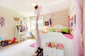 Baby girl room interior with white bed and pink curtains. — Stock Photo