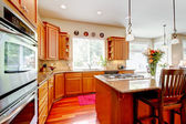 Wood luxury large kitchen with red and granite. — Stock Photo