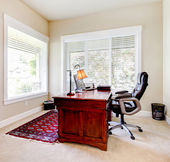 Home office with mahogany desk and letaher chair. — Stock Photo