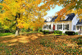Classic New England American house exterior during fall. — Stock Photo