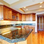 Luxury apartment wood kitchen with granite countertop. — Stock Photo