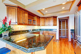 Luxury apartment wood kitchen with granite countertop. — Stock Photo