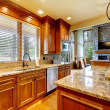 Luxury wood kitchen with granite countertop. - Stok fotoğraf