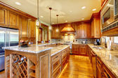 Luxury wood kitchen with granite countertop. — Stock Photo