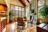 Luxury mountain home diining and living room with fireplace. — Stock Photo