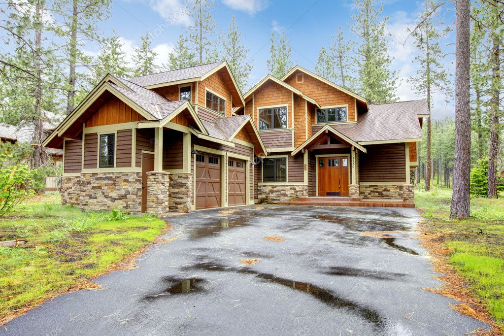 Mountain Luxury Home With Stone And Wood Exterior Stock