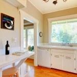 White kitchen with cherry hardwood floor. — Stock Photo