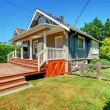 Stock Photo: Small grey house with back porch and old fence.