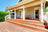 Back porch of small grey house with bench — Stock Photo