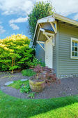Grey small outdoor shed with backyard landscape. — Stock Photo