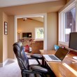 Foto Stock: Home office and computer and chair with brown walls.