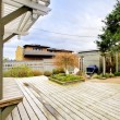 Stock Photo: Spring backyard with large deck and wood structures.