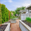 Stock Photo: Spring backyard with garden beds and wood structures.