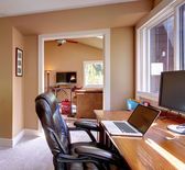 Home office and computer and chair with brown walls. — Stock Photo