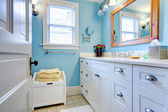 Blue and white bathroom with lots of storage space. — Stock Photo