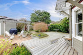 House large deck and backyard during early spring. — Stock Photo