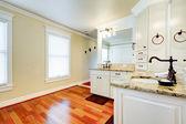 Luxury large white master bathroom with cherry hardwood. — Stock Photo