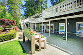 Large house back yard with two decks and flower boxes. — Stock Photo