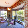 Breakfast table with brick walls and old carpet. — Stockfoto