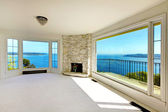 Luxury real estate bedroom with water view and fireplace. — Stock Photo