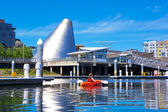 Tacoma downtown marina with Glass Museum and kayaker. — Stock Photo