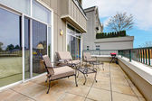 Balcony with furniture in new apartment building. — Stock Photo