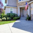 Stock Photo: House exterior with driveway and Americflag.