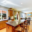 Wood classic large kitchen with granite island. — Stock Photo
