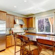 Wood classic large kitchen with granite island. - Stock Photo