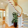 Stock Photo: Curved staircase with hallway and hardwood floor.