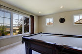 Large family room with pool table and tv. — Stock Photo