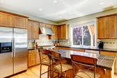 Wood classic large kitchen with granite island. — Stock Photo